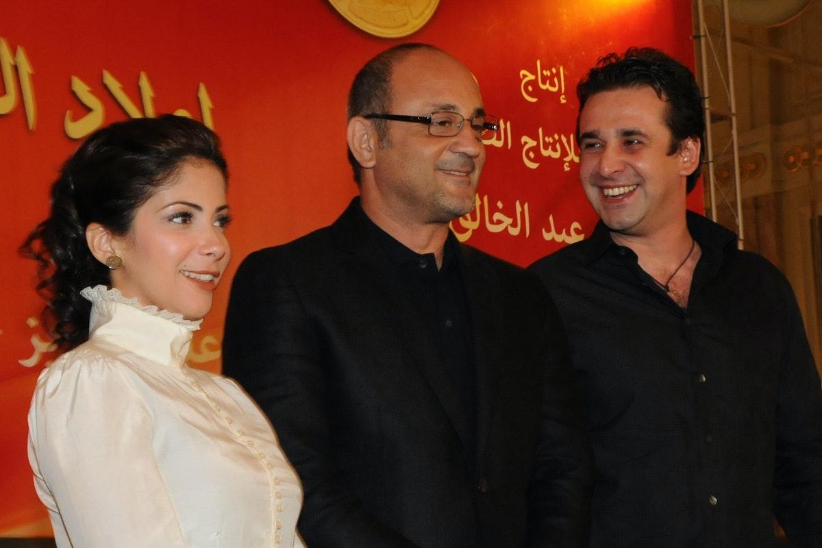 منى زكي مع كريم عبد العزيز والمخرج شريف عرفة  - AFP