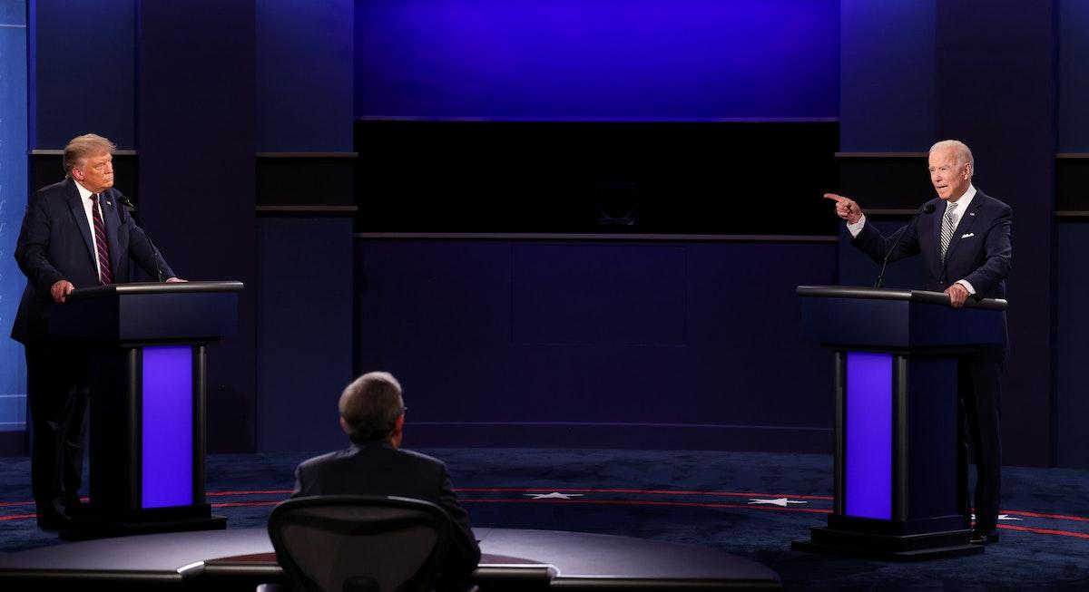 دونالد ترمب ومنافسه جو بايدن خلال مناظرة سابقة في كليفلاند - REUTERS