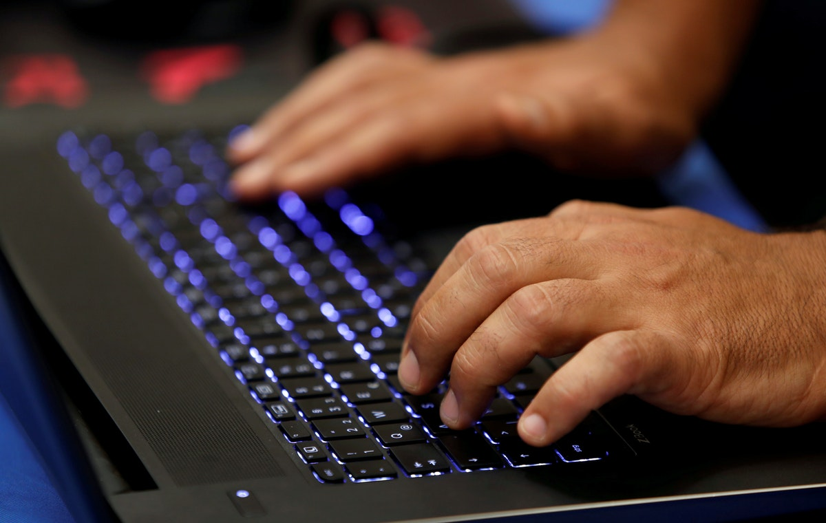 A man types into a keyboard during the Def Con hacker convention in Las Vegas - REUTERS